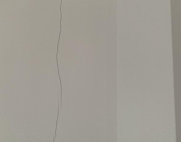 cómo arreglar las grietas en la pared